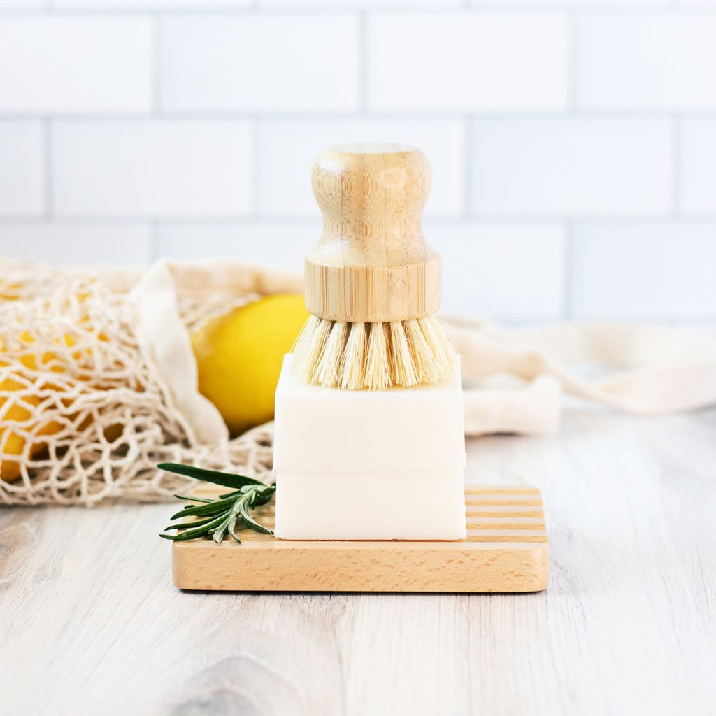 This solid dish soap bar recipe makes 2 eco friendly dish soap bars and each can lasts up to six months worth of dirty dishes!!