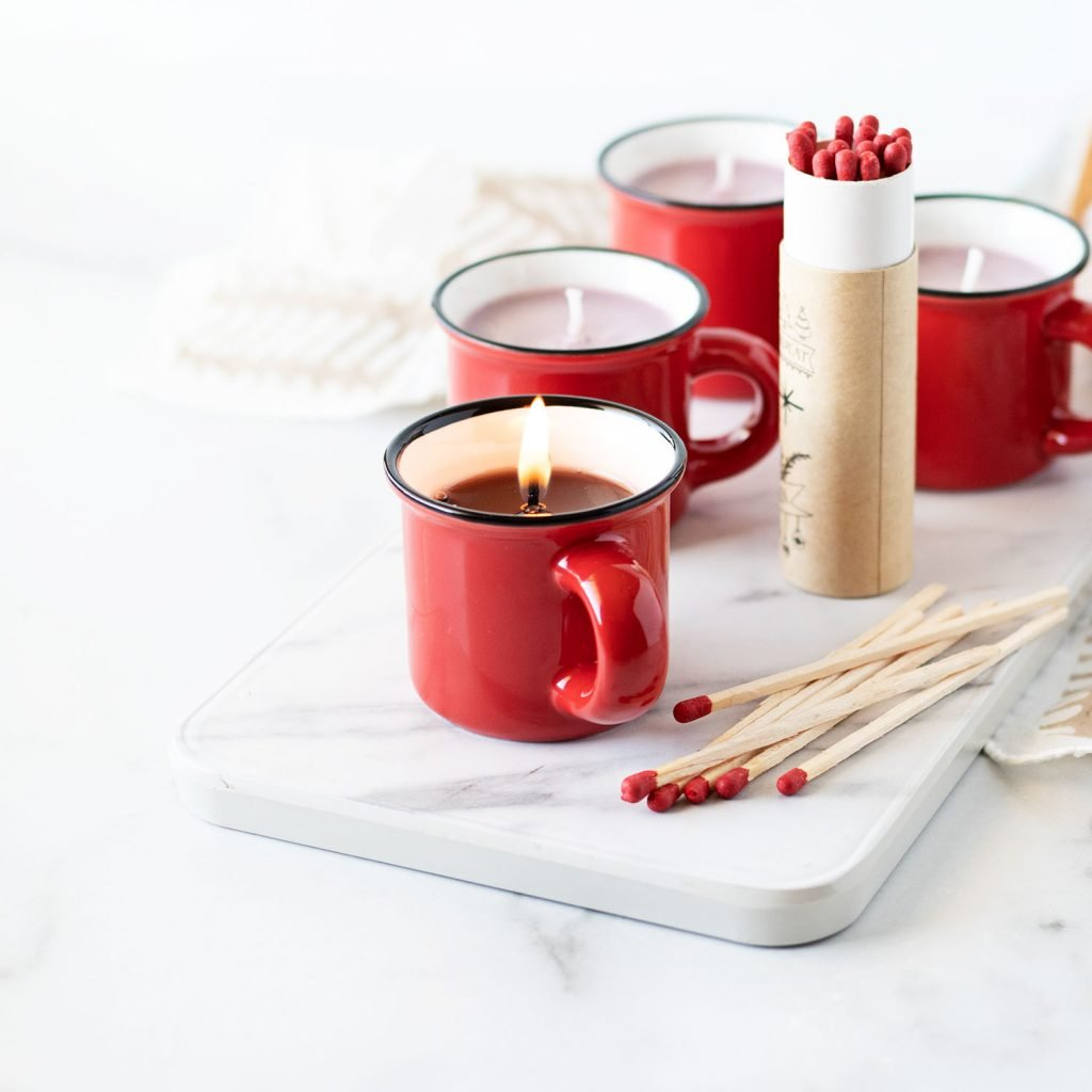 If you're looking for an affordable DIY candle gift that is easy to make, you are going to love making these hot cocoa peppermint candle mugs!